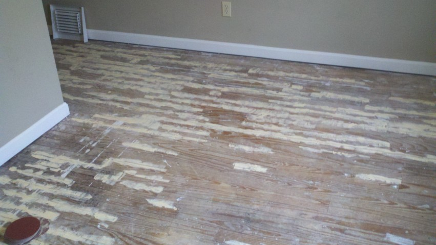 seriously damaged and scratched wood floor