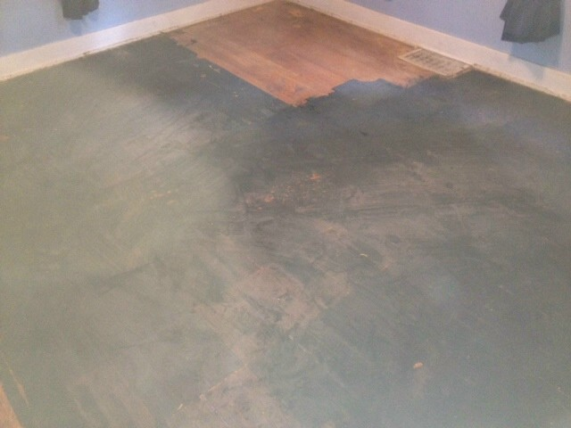 damaged floor before wood refinishing Atlanta, GA