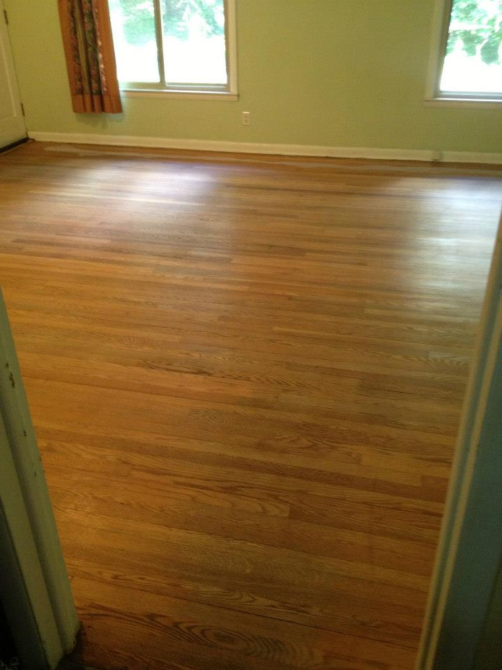 Before wood floor refinishing in Alpharetta, GA